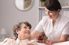 Female carer with elderly residents